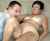 Grandma fucks on couch with younger man