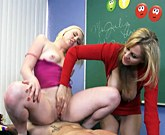 Sex teacher Julia Ann sharing with Caroline Cross a large dick in the classroom