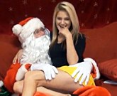 Merry Christmas – Santa and young beautiful blonde