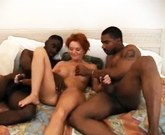 Horny wife with young black lovers in her marital bed