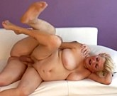 Shorthair granny with big tits fucks on white couch
