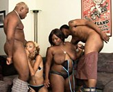Blonde and brunette ebony girls fucking with two black men side by side