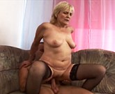 Mature mom meets up with a young lad and fucks on couch