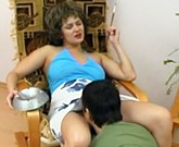 Mature Russian with big boobs Emilia fucks with young lover in a chair