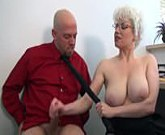 Busty blonde Scarlet gives good handjob in office